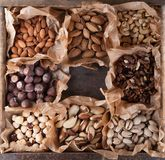 Collection of nuts in a wooden box. Royalty Free Stock Photography