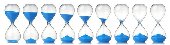 Free Collection Of Hourglasses With Blue Sand Showing The Passage Of Time Royalty Free Stock Images - 150677819