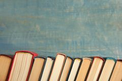 Free Collection Of Old Books On Wooden Background. Space For Text Stock Photography - 164671472