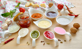 Collection Of Sauces On The Wooden Background. Stock Photos