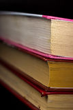 Collection old books against a dark background Royalty Free Stock Photos