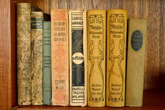 Collection of old books in German language. Weimar, Germany – April 12, 2016. Collection of old books in German language on a bookshelf Stock Images