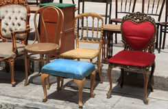 Collection of old broken chairs on the flea market. Stock Images
