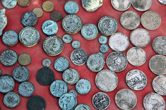 Collection of old coins from different countries. El-Jem market, Tunisia Stock Photo