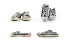 Collection of old direty sneakers on a white background. Royalty Free Stock Photography