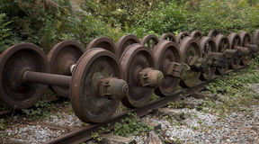 A collection of old discarded train wheels Royalty Free Stock Images