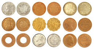 Collection of old Indian coins of British colonial. Regime over white background Royalty Free Stock Photos