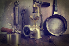 A collection of old kitchen utensils. Tinted Photos Stock Image