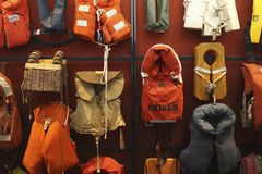 Collection of old life jackets. A collection of old life jackets at The National Lifeboat Museum Dorus Rijkers in Den Helder, The Netherlands. The museum is royalty free stock photography
