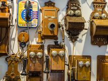 Collection of old obsolete telephones exhibits in the museum. MOSCOW, RUSSIA - MARCH 20, 2018: Collection of old obsolete telephones exhibits in the museum of Stock Images