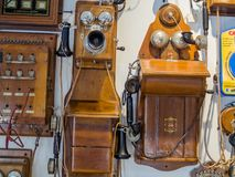 Collection of old obsolete telephones exhibits in the museum. MOSCOW, RUSSIA - MARCH 20, 2018: Collection of old obsolete telephones exhibits in the museum of Stock Photos