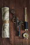 Collection with old pistol, map, compass and telescope Royalty Free Stock Photo