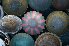 Collection of old rarity metal, ceramic and silver plates. On wooden background Stock Image