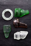 Collection of old sea glass bottlenecks Stock Photography