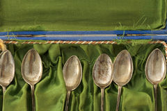 Collection of old silver spoons in velvet box Royalty Free Stock Photo