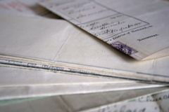 A collection of old vintage family documents. A collection of old vintage hand written family documents royalty free stock images
