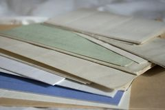 A collection of old vintage family documents. A collection of old vintage hand written family documents royalty free stock image