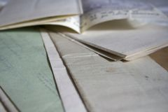 A collection of old vintage family documents. A collection of old vintage hand written family documents stock photo