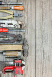 Collection of old working tools and instruments on wooden grey b Royalty Free Stock Image
