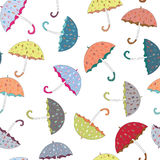 Collection of orange, yellow, blue umbrellas with drawn rainy drops seamless pattern. Vector illustration on white background. Hand drawn colorful umbrellas with vector illustration