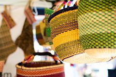 Weaved basket bags. A collection of organic hand weaved basket bags on display at a vintage pop up market stall stock images