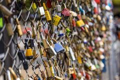 Padlocks on a fence to symbolise love royalty free stock photography