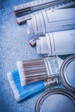 Collection of paint brushes cans construction drawings wooden me Royalty Free Stock Image