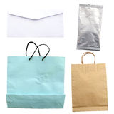 Collection of paper bag and foil package on white.  Royalty Free Stock Image