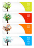 Collection of paper banners with four season trees Stock Photos