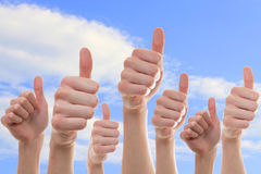 Collection of people showing thumbs of. Nice thumbs up collection with blue sky as a background Stock Photos