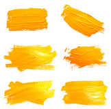 Collection of photos yellow ochre strokes. Of the paint brush isolated on a white stock illustration