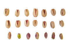 Collection of Pistachio nuts, isolated on white background Royalty Free Stock Images
