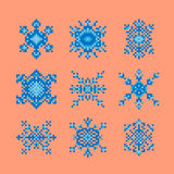 Collection of pixel art style snowflakes. Vector collection of different  snowflakes. All objects made in pixel art style Royalty Free Stock Images