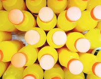 Bottles of fresh orange juice. Collection of plastic bottles of fresh orange juice Stock Images