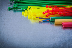 Collection of plastic cable ties electric wires on metallic back Royalty Free Stock Image