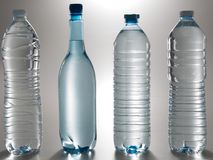 Collection of Plastic set water bottles. In grey Royalty Free Stock Photo