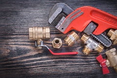 Collection of plumbers equipment on wooden board plumbing concep Stock Photo