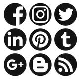 Collection of popular circle black social media logos printed on. Kiev, Ukraine - September 06, 2016: Collection of popular circle black social media logos Stock Images