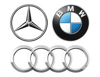 Collection of popular German car logos. Kiev, Ukraine - September 12, 2016: Collection of popular German car logos printed on white paper: Mercedes, BMW and Audi Royalty Free Stock Photo