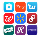 Collection of popular shopping icons printed on paper. Kiev, Ukraine - February 22, 2016: Collection of popular shopping icons printed on paper: Apple Store Royalty Free Stock Photography