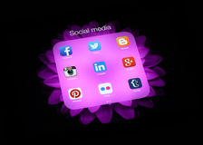 Collection of popular social media logos on iPad screen. KIEV, UKRAINE - APRIL 30, 2015:Collection of popular social media logos on iPad screen:Facebook, Twitter stock illustration