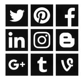 Collection of popular square black social media logos. Kiev, Ukraine - October 10, 2016: Collection of popular square black social media logos printed on paper Stock Photos