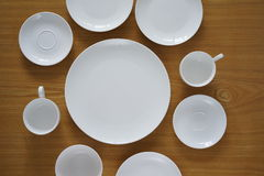 Collection of porcelain plains on wooden table Stock Photography