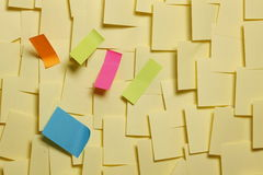 Adhesive Notes. A collection of post it notes in several shapes and colors Royalty Free Stock Photography
