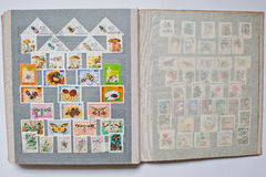 Collection of postage stamps in album from different countries a Royalty Free Stock Images