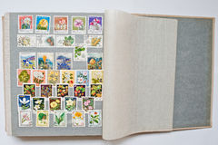 Collection of postage stamps in album from different countries a Stock Photography