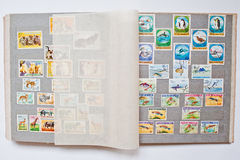 Collection of postage stamps in album from Guinea and Mongolia Stock Photo