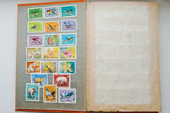 Collection of postage stamps in album from Vietnam Stock Images