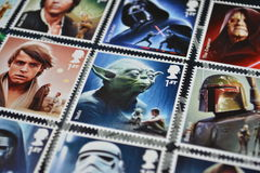Royal Mail stamps Star Wars. Collection of Royal Mail  stamps with Star Wars movie characters with Luke Skywalker and Yoda in the centre Royalty Free Stock Image