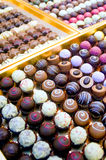 Collection of Pralines. In a golden Box Royalty Free Stock Photography